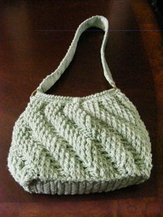 Crocheted purse.  Took me a while, but I finally figured out this pattern from that great lavender purse on so many other boards.  Have to be careful not to make the opening too narrow at the top.  Closes with magnetic snap.  Crocheted strap lined with grosgrain ribbon.