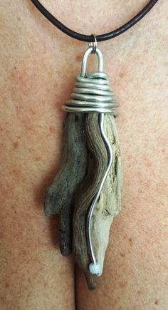 Looks like drift wood with sterling silver made into a beautiful pendent!