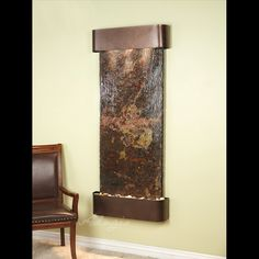 This mountable waterfall feature looks amazing in my kitchen.  Come see us at http:///www.waterfeaturesupply.com/waterwalls/indoor-wall-water-fountains.html to  find out more about this mountable water feature fountain.