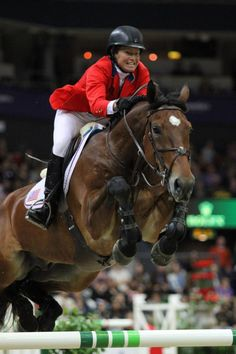 Beezie Madden & Simon FEI World Cup 4-26-13. Now that's a horse and rider giving it their all.  Coolness.