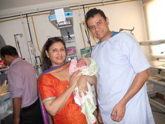 Dr.Rita with a Montie from canada who becomes a dad by Surrogacy in India