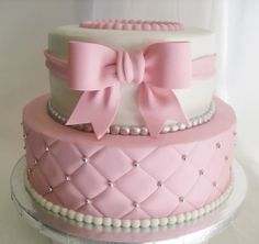 Beautiful Pink& White Cake. Love the quilted look of the bottom layer and the embellishments.
