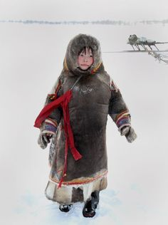 A young Nenets girl from Yamal, Siberia stays warm in her reindeer skin clothing. Temperature was around -20 degrees C. They have a saying there ' There's no such thing as bad weather, only bad clothing' Well, maybe that's true.....