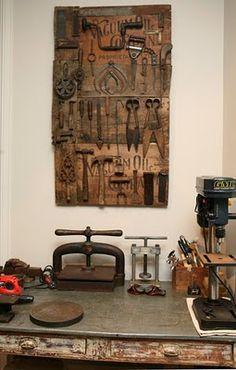 Tools hung on old wood panel in Judy Wilkenfeld's studio - Red Velvet