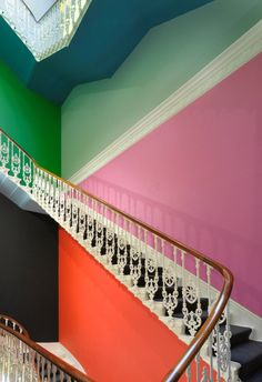Colourful walls with old stair case and railings