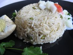 "Ghee Rice (Gowdru palao)  1 Cup Basmati Rice    1 1/2 cups Water        1 Cup Cauliflower florets    1/4 Cup Peas (fresh/frozen)        2 Onions        2 tsp ghee                       Grind to a rough paste:                 5-6 Green chillies        1/4pc cinnamon        2 cloves        3-4 Garlic cloves        ½ "" pc Ginger        1-2 Cardamom        ½ bunch coriander                 Oil        Salt to taste        2-3 whole hard boiled eggs (optional)                     Heat oil in a…"