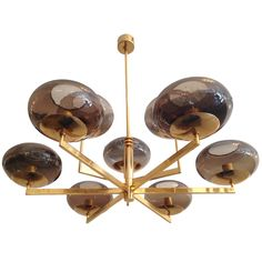 View this item and discover similar for sale at - An Italian polished brass gold tinted fixture with smoked glass shades. Nine light sources. Chandelier Pendant Lights, Pendant Lamp, Chandeliers, Lamp Design, Lighting Design, Design Design, Ceiling Lamp, Ceiling Lights, Drop Lights