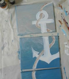 Trio of DIY canvas paintings depicting one ship anchor in shades of blue. Image only >aaaaAnchorpaintings-026.jpg (570×653) #Coastal #anchor #art