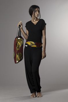 black cotton jersey t-shirt with trousers wax and leather belt and bag
