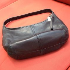 Authentic Coach hobo Rare! Buttery soft black leather hobo. Leather is in excellent condition. Inside needs to be cleaned but there are no rips or tears. I would be willing to take it to get cleaned for the buyer. 2 large interior slip pockets and 1 zipper pocket. Coach Bags Hobos