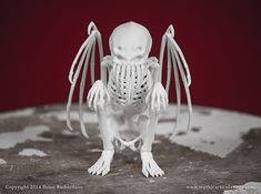 This is a digitally sculpted, 3D printed replica of a Cthulhu Skeleton. It measures 2.5 inches long by 3.4 inches wide by 4 inches high. This