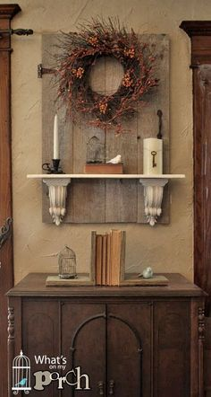 Vintage Wood Door with a wreath, corbels and bookshelf.