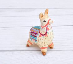 This listing is for the little alpaca with purple & turquoise embellishments. Each figure is sculpted in polymer clay with a fashionable clothing