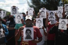 Students from Ayotzinapa Teacher Training College Raul Isidro Burgos hold pictures of missing students outside the General Attorney building in Chilpancingo, in Guerrero, October 7, 2014. The students went missing after they clashed with police in Iguala in Guerrero on Sept. 26. A mass grave was found near the town over the weekend, full of charred human remains. Guerrero's attorney general, Inaky Blanco, said that 28 bodies have been found at the site so far, and it  REUTERS/Jorge Dan Lopez