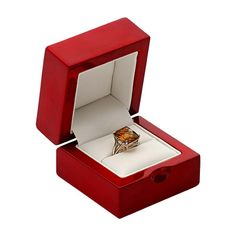 Premium Rosewood Ring Gift Box  Item #: 40198224 This slightly domed rosewood box is beautifully finished and just the right touch for high-end designer pieces--the box itself becomes a treasure! Ideal for large or tall ring designs, the padded insert is covered with white faux leather and holds one ring. The box has a high-gloss lacquered finish and features a thumb notch for easy opening. White faux leather lines the interior and covers the hinge. Delivered in a two-piece drop-side packer.