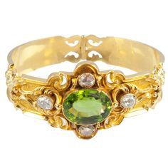 Peridot, diamonds, and gold Victorian bracelet, circa 1880