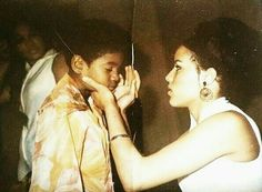 Ms. DePasse touching up MJ's face.