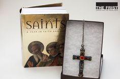 "This gorgeous handcrafted cross necklace will add a pop of color and bold style to your wardrobe. Make the perfect impression this holiday season with this piece created by a Nashville local artist and priced at $195. Create a gift set with the necklace and ""Saints: A Year in Faith and Art"", an illustration book of the saints of the liturgical calendar. Each saint is depicted with world-famous works of art and a brief description of their religious life which is available for $19.95."