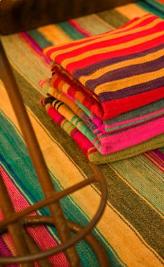 bolivian frazadas from l'aviva home -called frazadas, have been handwoven by aymara women in the andean region since pre-hispanic times, and used to protect against the high altitude cold. weaving of each frazada is done in two separate parts which are then sewn together; this central seam shows decorative details and colors that highlight the beauty of the tapestry