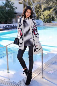 knitted cardigan with striped top and leather pants
