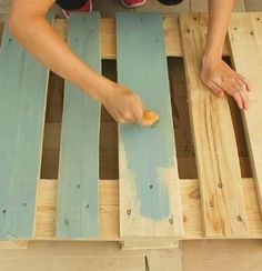 She carefully stains a pallet blue and wait until you see what she does in her living room!