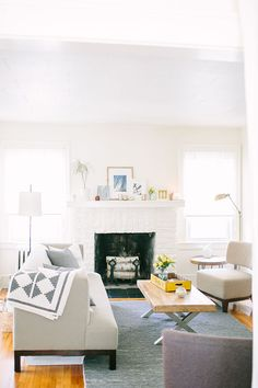 White brick fireplace with neutral walls and furniture