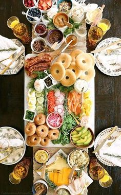 The ultimate bagel bar brunch spread out on the table. Use these ideas and printable checklist to plan your own brunch party.
