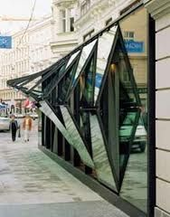 Great way to prevent injuries to pedestrians on the sidewalk (and patrons inside - and from taking up too much precious Vienna sq. The glass facade of Fabios restaurant in Vienna, a very unsual design yes, but highly ingenious too! Kinetic Architecture, Folding Architecture, Architecture Design, Facade Design, Amazing Architecture, Contemporary Architecture, Exterior Design, Interior And Exterior, Design Design