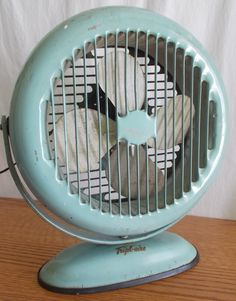 Working Vintage Tripl-Aire Fan, Aqua,  Desk / Wall Mount 1960s -- Free Shipping. $68.00, via Etsy.