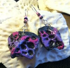 Free shipping to the US..... Black with splashes lavender and pink alligator scute with matching glass beads on hypoallergenic wires. on Etsy, $18.00