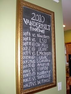 The family's favorite team's schedule displayed on the wall.