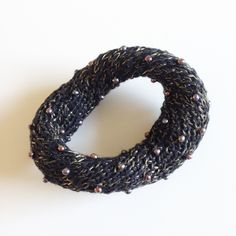 "NORA FOK TWISTED  Wrist piece. Knitted linlon and black pearls  4.75"" wide"
