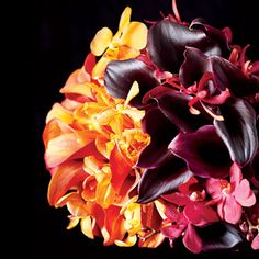 red dendrobium orchids and buffalo orange vanda orchids. Floral design by Banchet Flowers, NYC, banchetflowers.com.