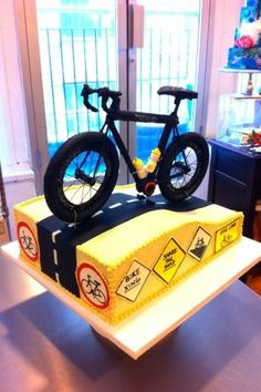 Bicycle Birthday Cake. This bicycle is made out of sugar based on secret pictures taken of the birthday guy's actual training bike.  He loved the surprise! Photo by Sugar Flower Cake Shop. www.sugarflowercakeshop.com