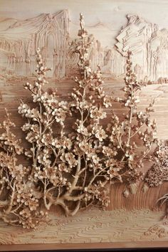 Detailed woodcarving of flower relief.