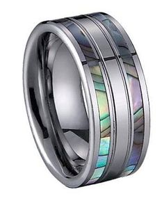 This uniquely designed tungsten ring features a shell inlay on either side of the band. When the ring hits the light, blue, green, purple and pink hues are emitted. To learn more visit: http://www.justmensrings.com/Tungsten-Ring-with-Shell-Inlay--JTG0034_p_410.html