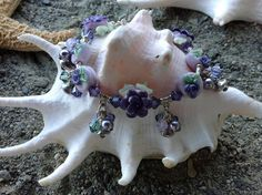Bracelet by torill-k with lampwork from CCdesign, swarovski-crystals and Sterling silver