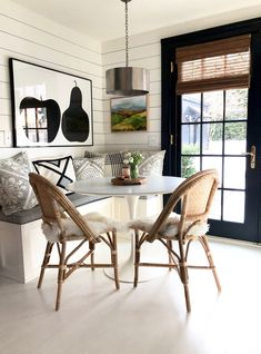 A built-in banquette and a round table makes a perfect kitchen nook with cafe chairs