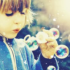 you can never be unhappy while blowing bubbles  ♥