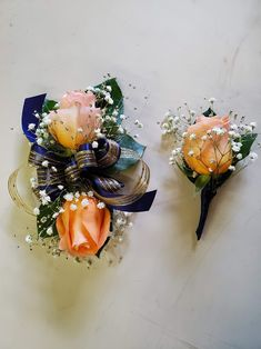 Peach roses, baby's breaths, and green leaves with navy and gold trim. Corsage And Boutonniere Set, Boutonnieres, Corsages, Green Leaves, Roses, Peach, Navy, Gold, Pink