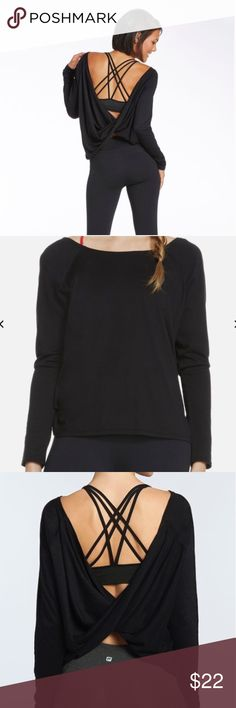 """FABLETICS Black """"SWITCHBACK TEE II"""" Top Shirt No trades. SOLD OUT EUC Basic Long Sleeve Fabletics tee in front and party in the back (or vice versa! - see last photo)  Take this must-have from daytime lounge to night out.   Switch up your look by experimenting with bold, strappy bras (bra in pics #1 and 3 is black and bra in pics #2,4,5 is red for contrast from black shirt for sale)   Soft Luxe Pima Cotton Breathable Fabric, Can Be Worn Forwards or Backwards  Fit: Relaxed All way Stretch…"""