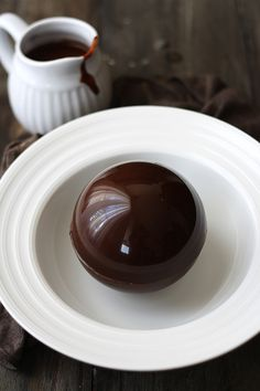 Chocolate bomb. Hard chocolate ball and, when you pour hot chocolate over it, the ball melts.