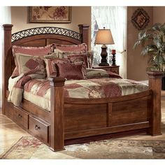 Ashley Timberline King Poster Headboard Bed (with under bed Storage) - The Timberline bedroom collection grasps the true beauty of country style furniture and brings it to your home. The replicated brown cherry grain is beautifully accented by the nicely scaled fretwork on the arched style of the headboard and mirror. Dream sweet dreams within the beauty of the rich country styled Timberline bedroom collection.