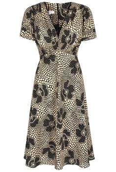 Based on our 1930's silk tea dress cut which is our best selling signature tea dress style because of its flattering nature, unique charm and versatility. A fabulous day dress new into the collection. A season-less style. The beautiful print was sourced from a french archive and is an original from the 1930's. Our fabulous printers in Como, Italy have translated this print onto a dry handle crepe de chine silk which has a wonderful drape. The skirt part of the dress is lined in black silk…