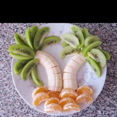 Palm trees made out of banans, kiwi slices, and mandarin oranges! #BirthdayExpress #JungleParty
