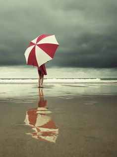 Stormy beach with umbrella..
