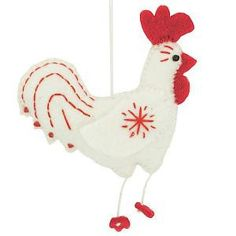 Fair Trade from Nepal.  Wake up bright and early on Christmas morning to this fuzzy, felted red and white rooster, a great addition to your holiday décor.