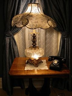 Awe, the telephone table & a beautiful lamp to go with. <3