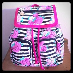 NWT Bestsey Johnson Rose Backpack New with tags black and white striped with bright roses  and many pockets for storage. Gold hardware and adjustable shoulder straps. Also comes with a small plastic pouch that's great for many things. Absolutely no flaws! Betsey Johnson Bags Backpacks