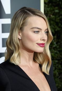 Margot Robbie Photos - Margot Robbie attends The 75th Annual Golden Globe Awards at The Beverly Hilton Hotel on January 7, 2018 in Beverly Hills, California. - 75th Annual Golden Globe Awards - Arrivals